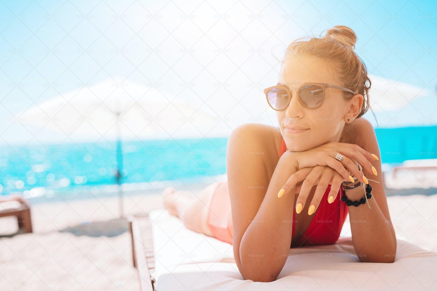 Woman On A Sun Bed: Stock Photos