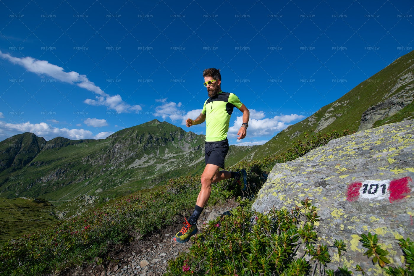 Athlete Running In Mountains: Stock Photos
