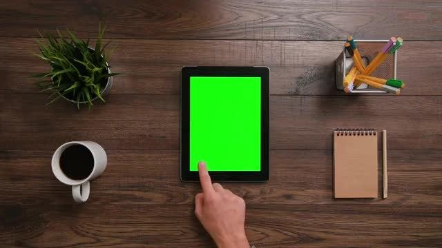 Scrolling An Ipad With Green Screen: Stock Video