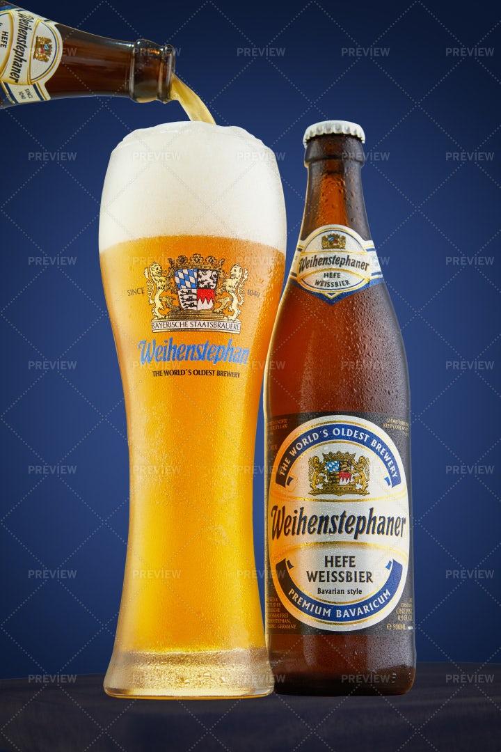 Pouring Weihenstefaner Beer: Stock Photos