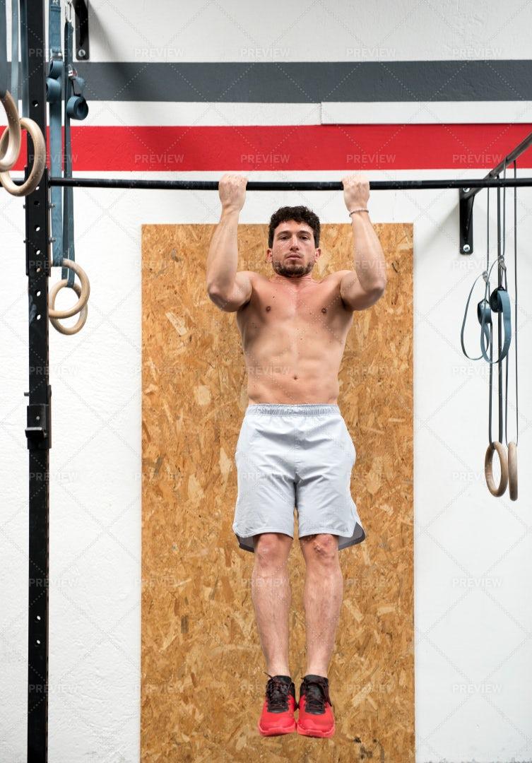 Athlete Doing Pull Ups: Stock Photos