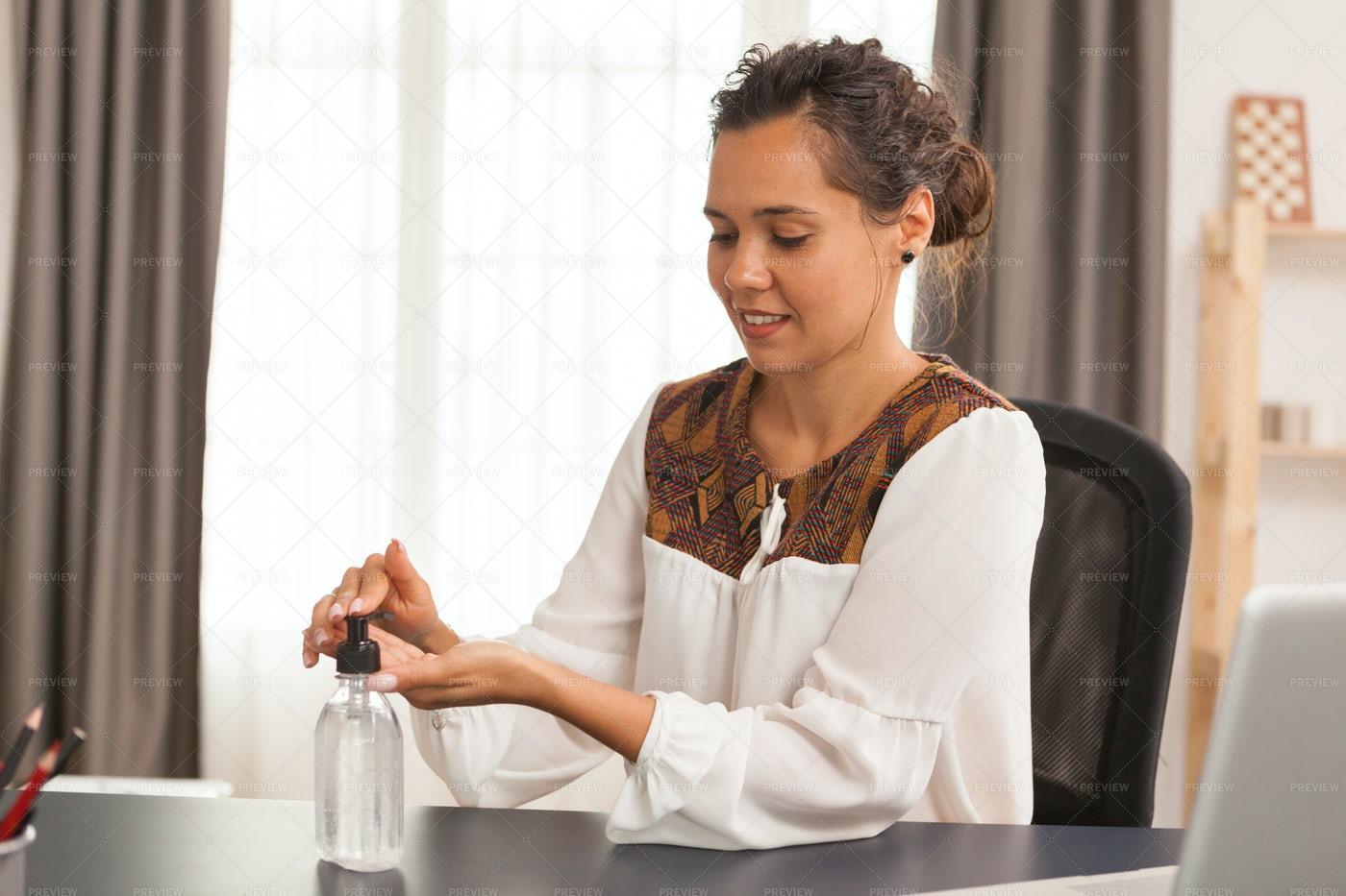Woman Disinfecting Her Hands: Stock Photos