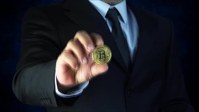 Businessman Holding Dollars And Bitcoins: Stock Video