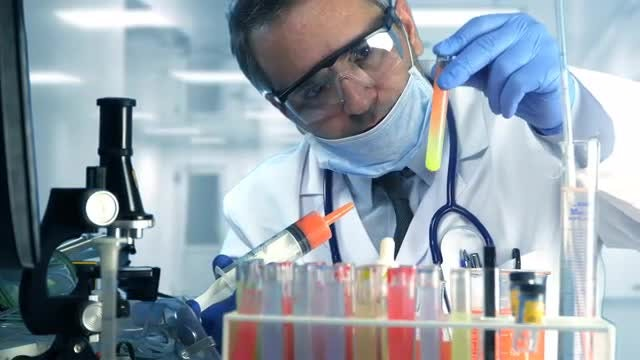 Doctor Experiment In Chemical Laboratory: Stock Video