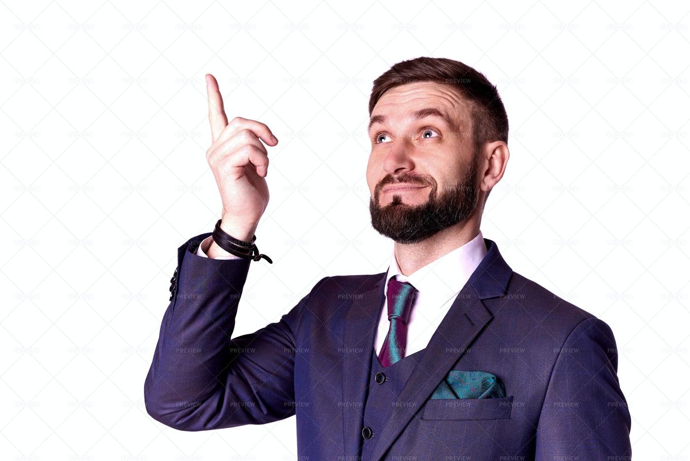 Businessman Points Up: Stock Photos