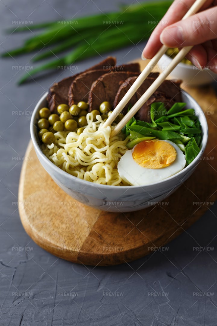 Eating Noodles With Chopsticks: Stock Photos
