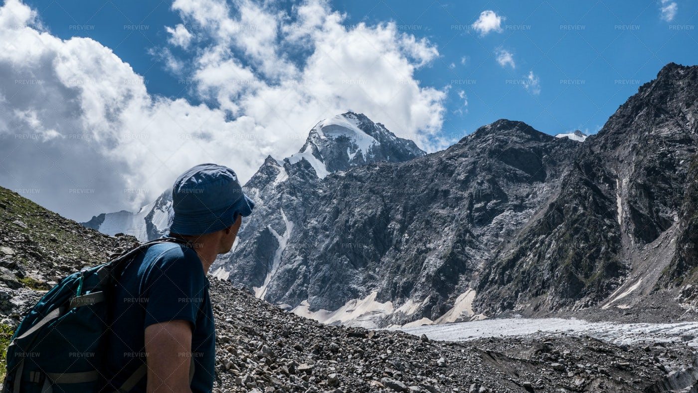Backpacker By The Mountains: Stock Photos
