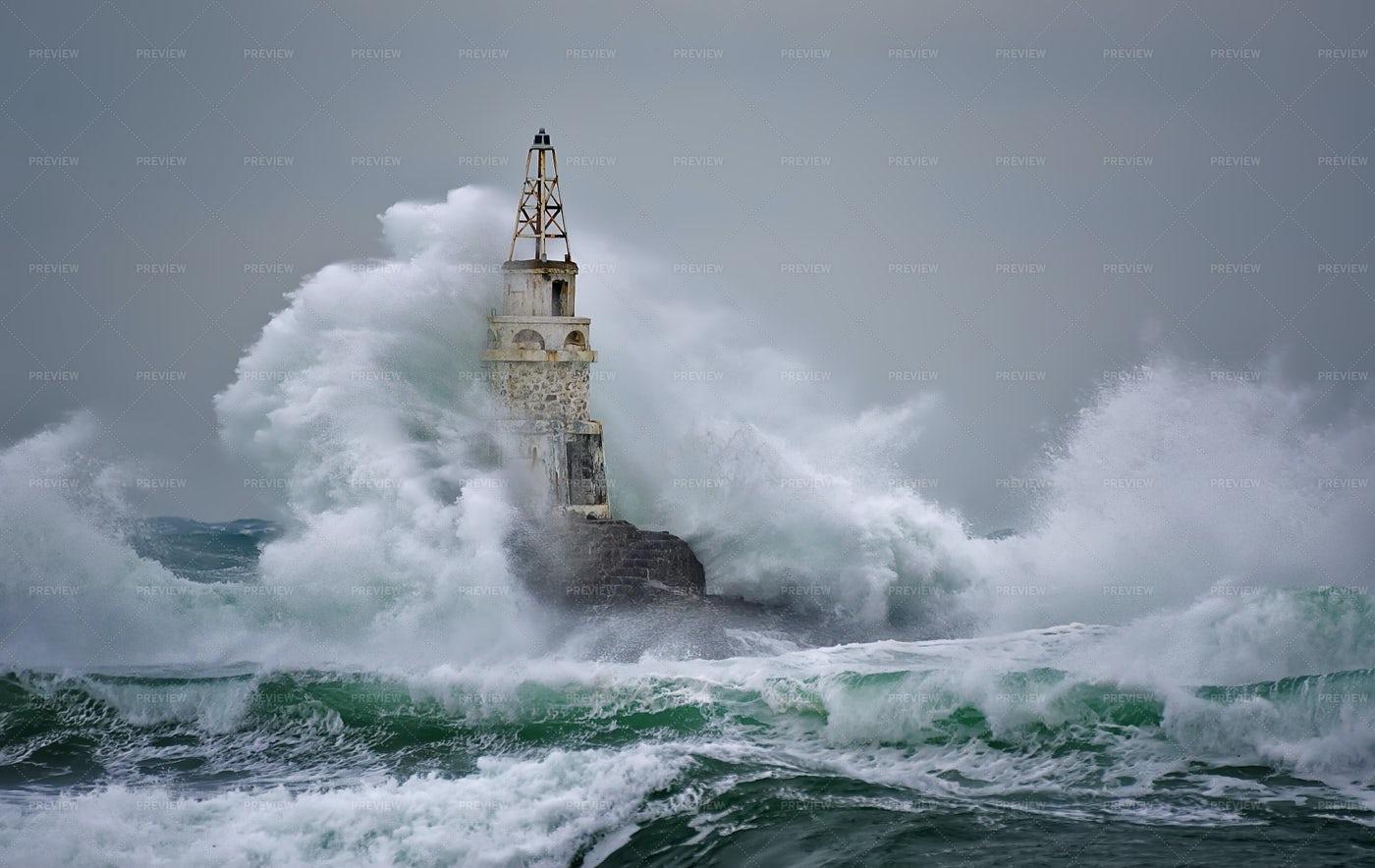 Waves Crash Against Lighthouse: Stock Photos