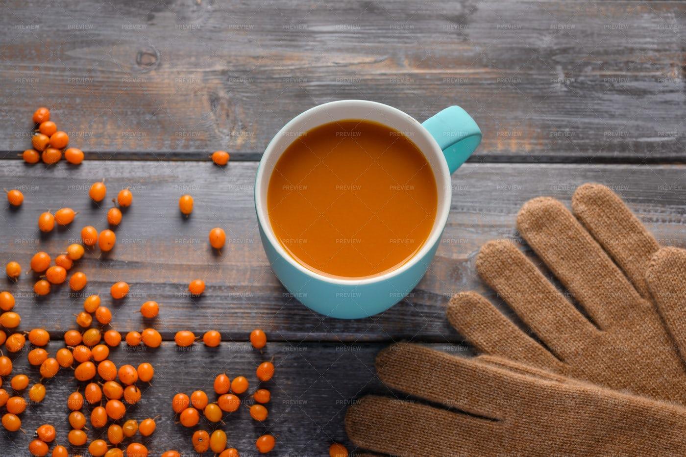 Buckthorn Juice In Mug: Stock Photos