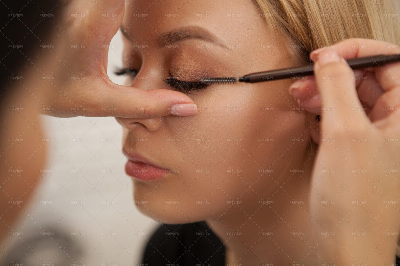 Applying False Lashes: Stock Photos
