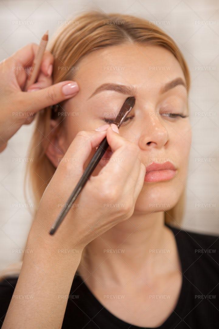 Woman Having Makeup Applied: Stock Photos