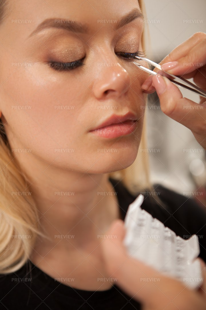 Getting Lashes Applied: Stock Photos