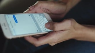 Woman Typing Message On Smartphone: Stock Video