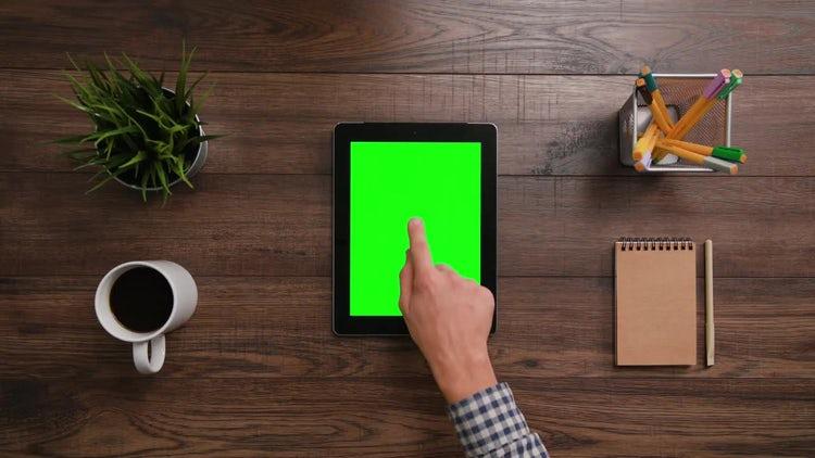 Man Clicks IPad with Green Screen: Stock Video