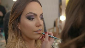 Applying Makeup - Blue Lipstick: Stock Video