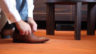 Man Tying Shoes: Stock Video