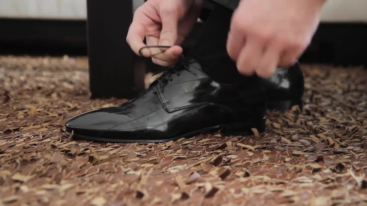 Tying Black Shoes: Stock Video