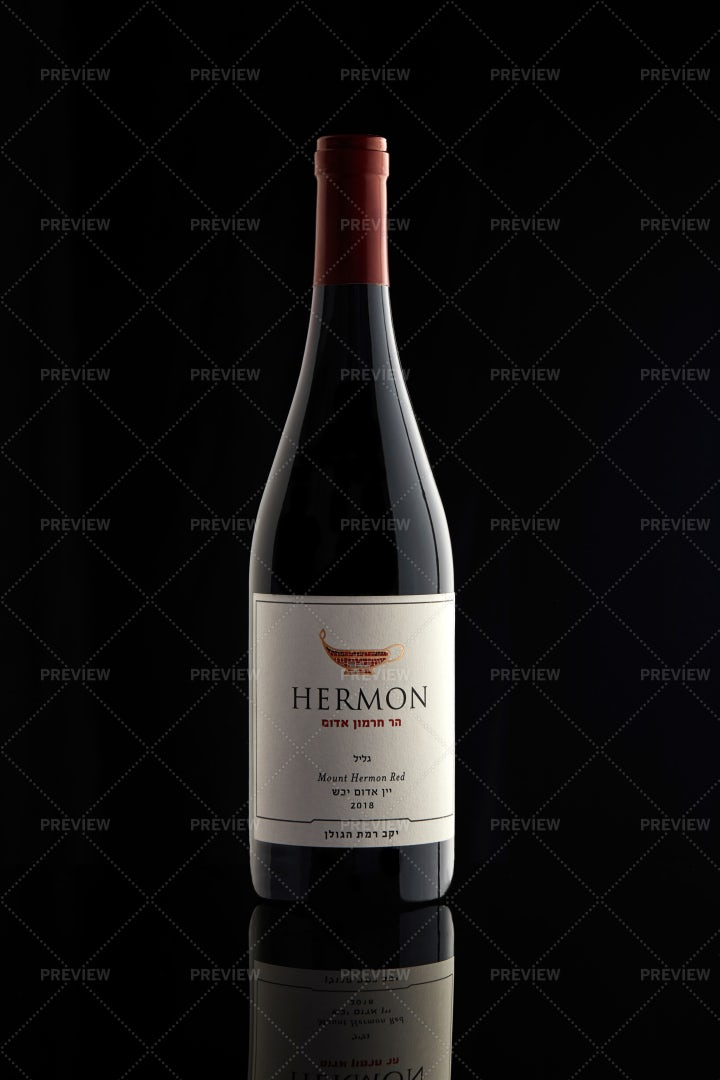 A Bottle Of Red Wine On A Black: Stock Photos