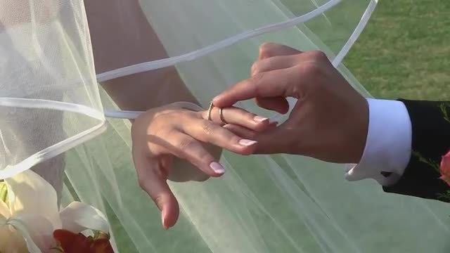 Groom Puts Ring On Bride: Stock Video