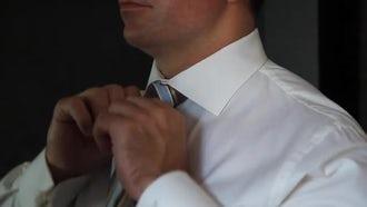 Groom Adjusts Wedding Tie: Stock Video
