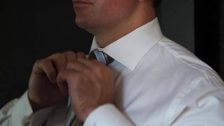 Groom Adjusts Wedding Tie: Stock Video