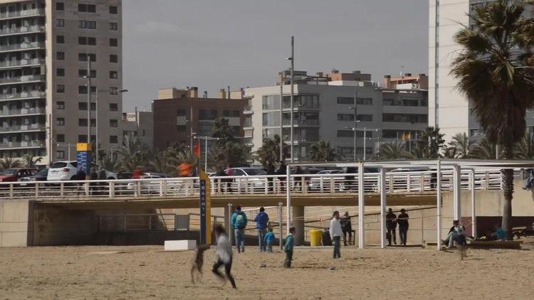 Kids Play On The Beach: Stock Video