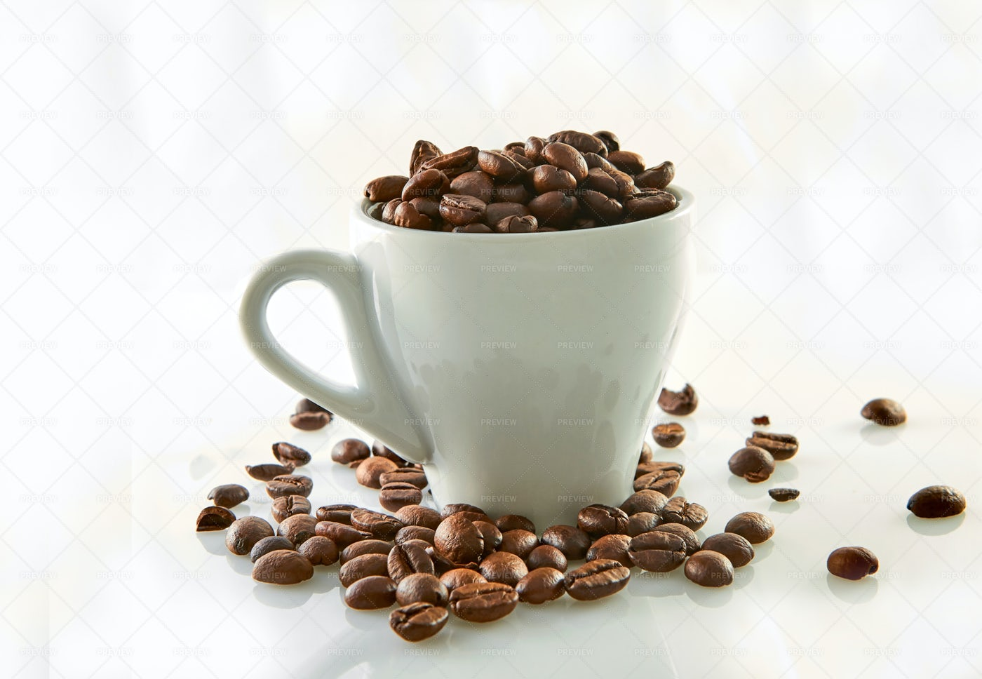 Beans In A Coffee Cup: Stock Photos