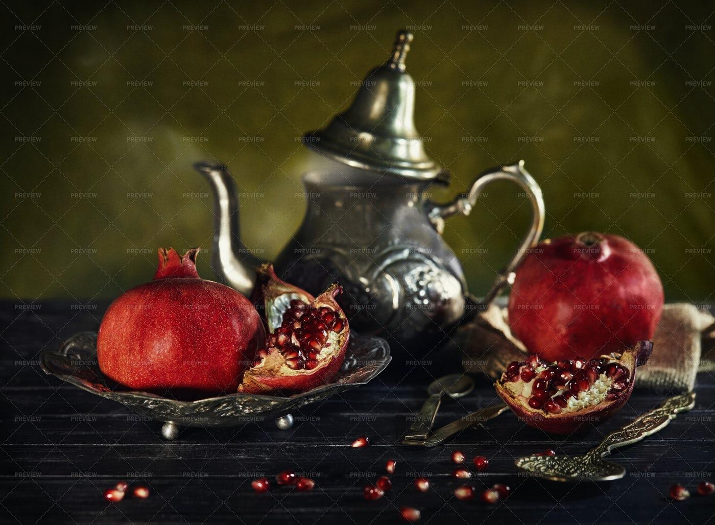 Pomegranates And Kettle: Stock Photos