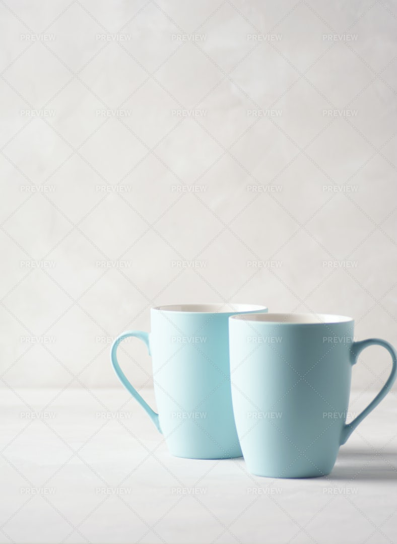 Two Pale Blue Mugs: Stock Photos