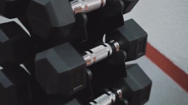 Returning Dumbells To Rack: Stock Video