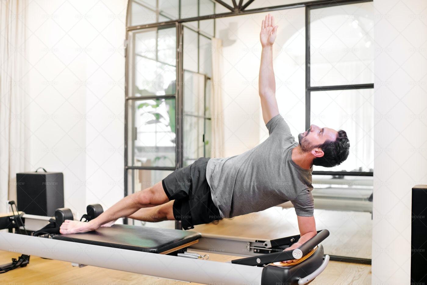 Fit Man Doing Pilates: Stock Photos