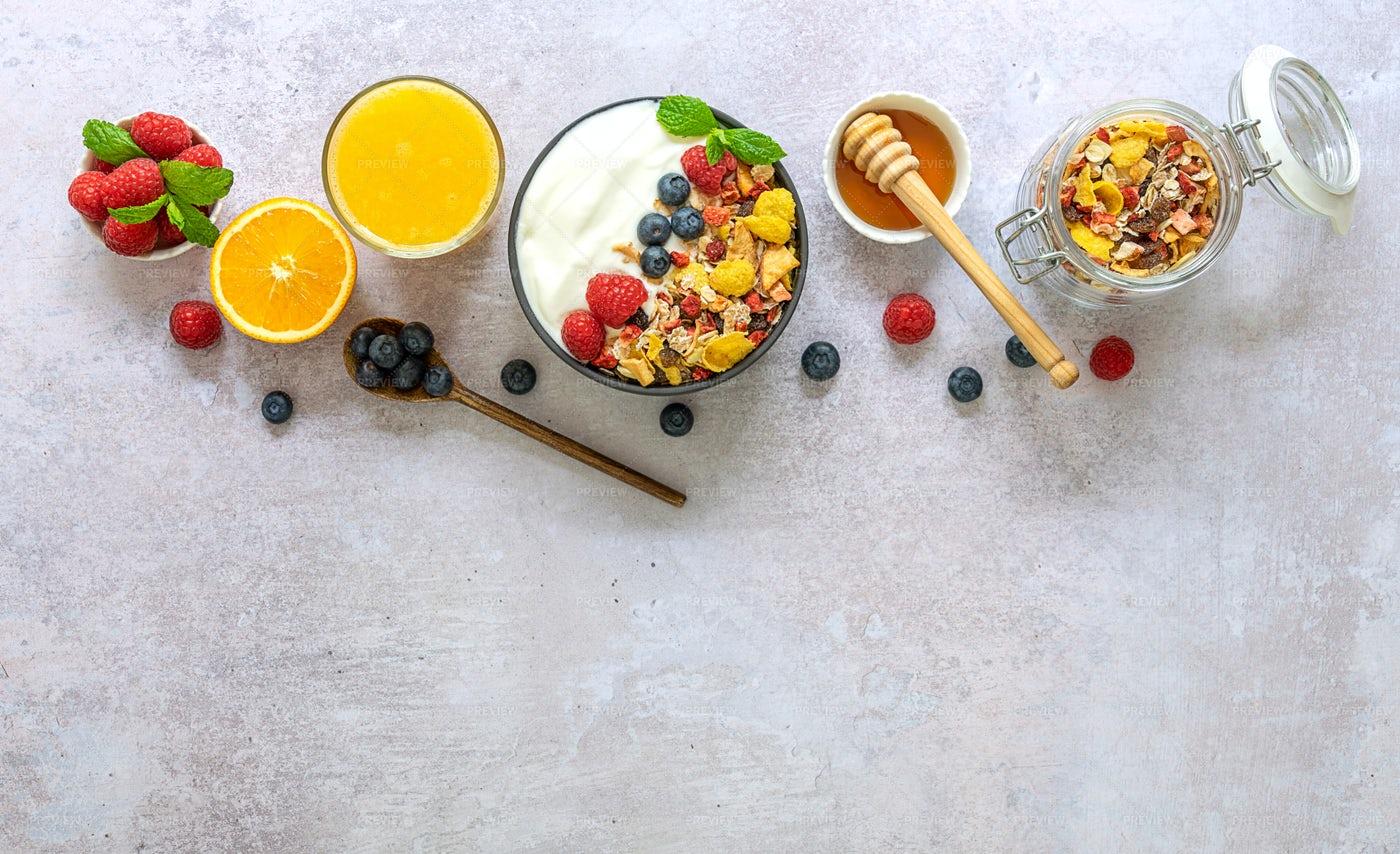 Flat Lay Musli Honey Berries And Orange: Stock Photos