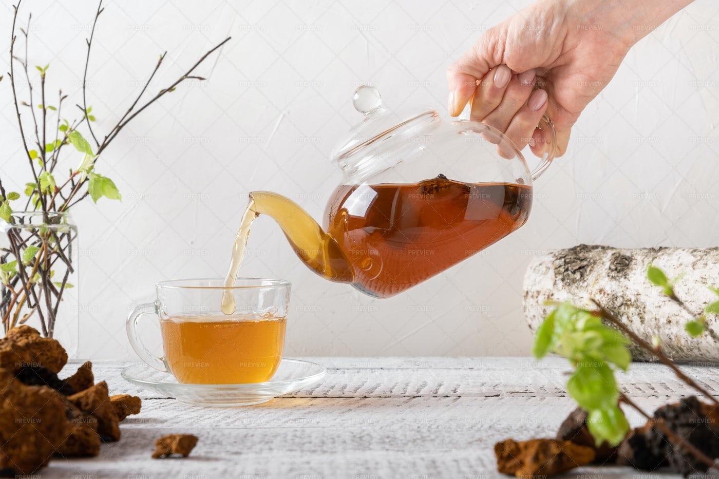Pouring Chaga Tea: Stock Photos