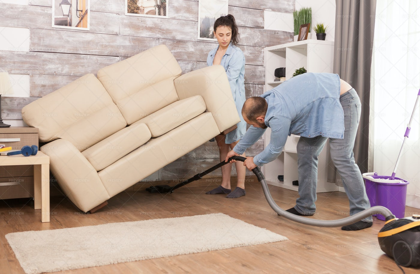 Cleaning Under Sofa: Stock Photos