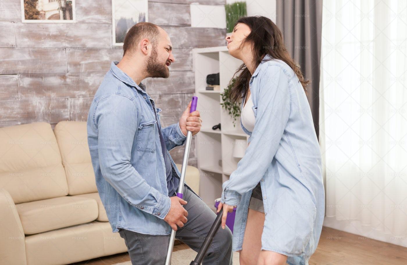 Singing And Housekeeping: Stock Photos
