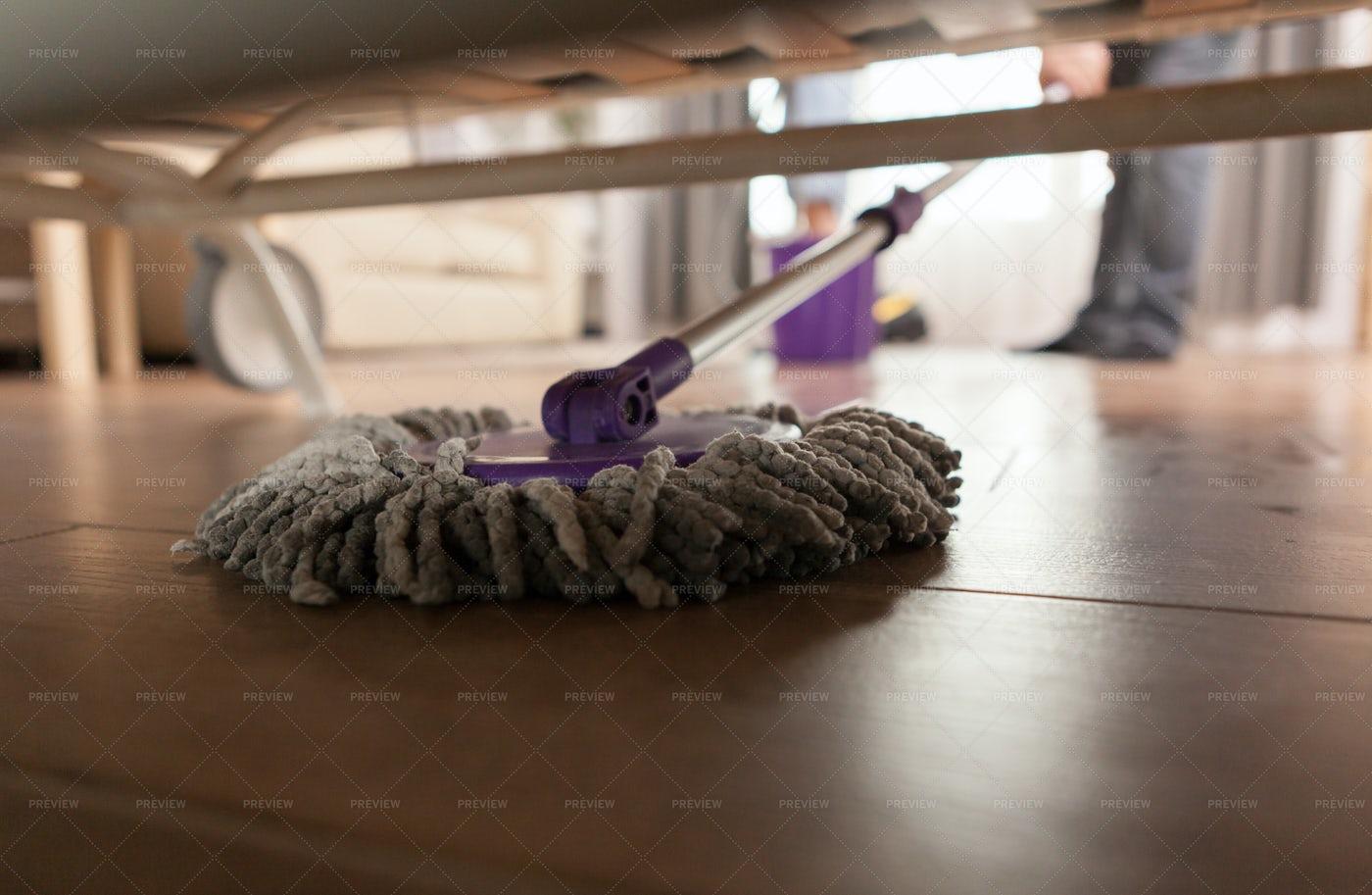 Mopping Under Sofa: Stock Photos