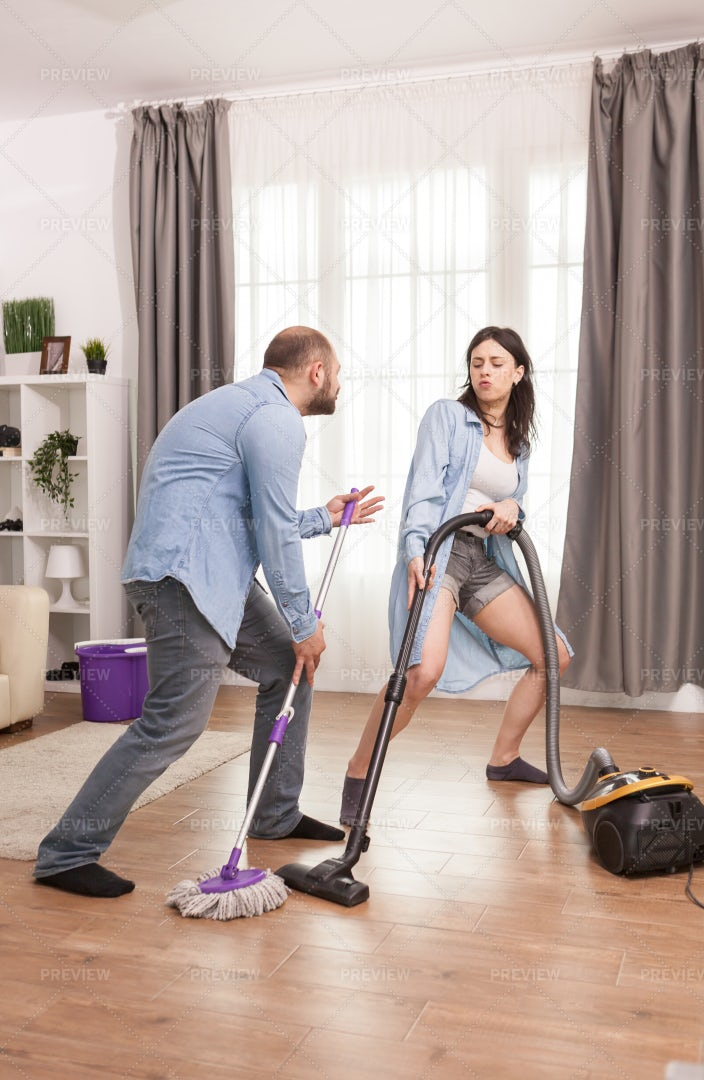 Dancing While Housekeeping: Stock Photos