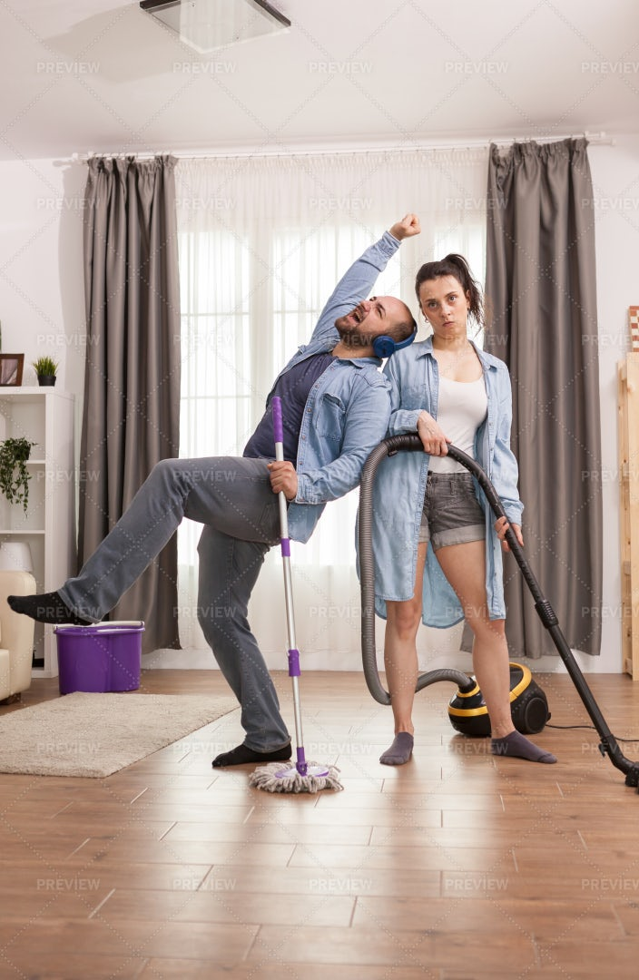 Couple Cleaning Apartment: Stock Photos