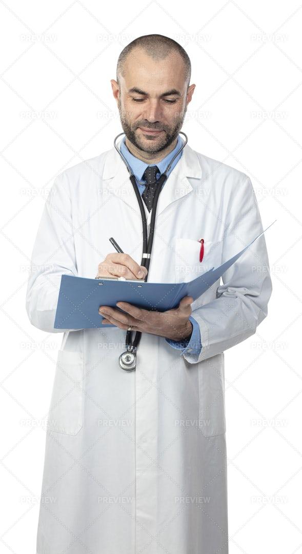 Doctor Writes Notes: Stock Photos