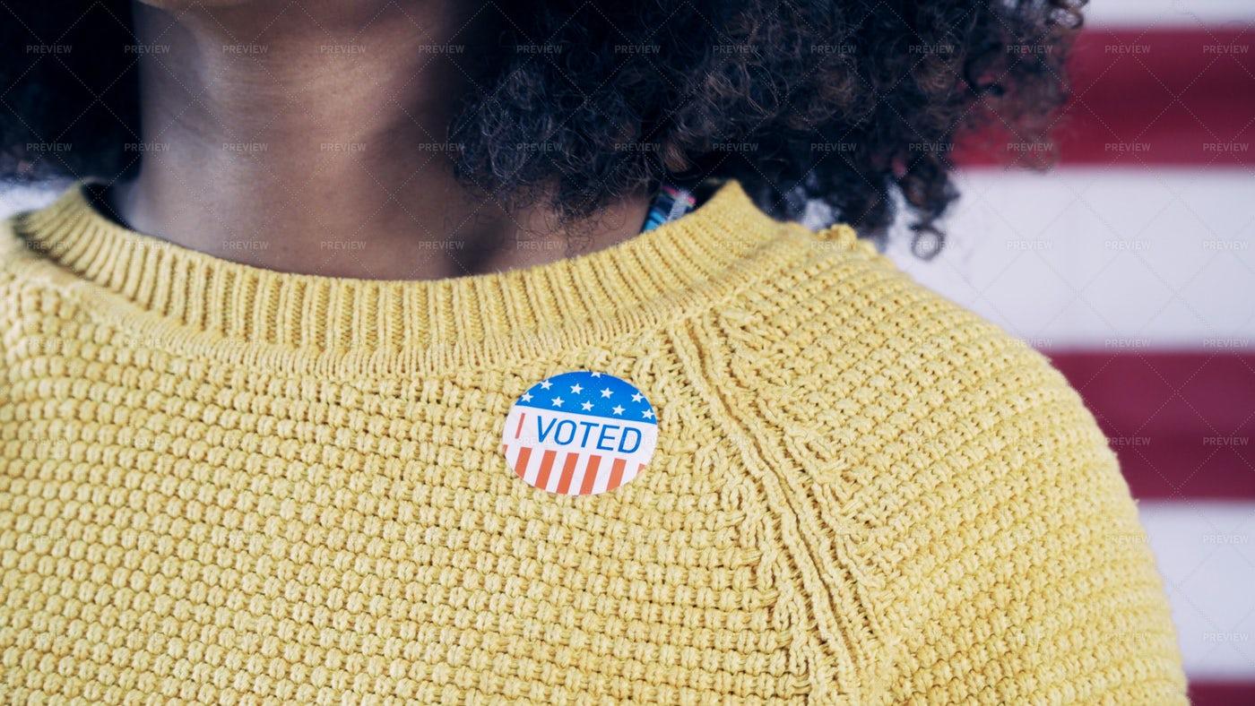 Woman Wearing Voter Sticker: Stock Photos