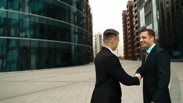 Two Businessman Shake Hands: Stock Video
