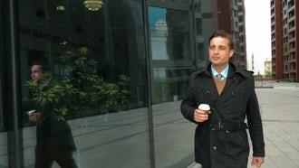Businessman Walking Drinking Coffee : Stock Video