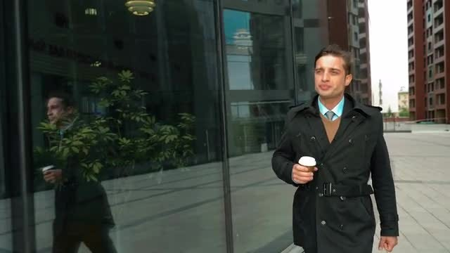 Businessman Walking Drinking Coffee : Stock Video