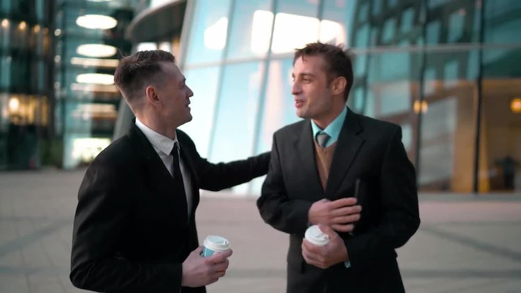Businessman Gives Coffee To Friend: Stock Video