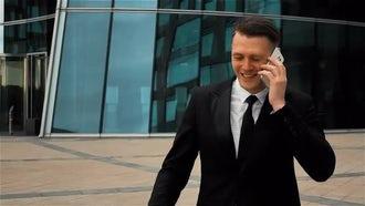 Businessman Talks On Phone: Stock Video
