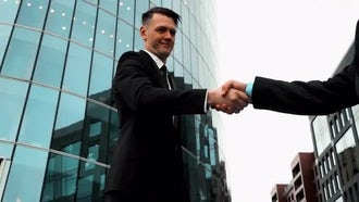 Business Associates Shaking Hands: Stock Video