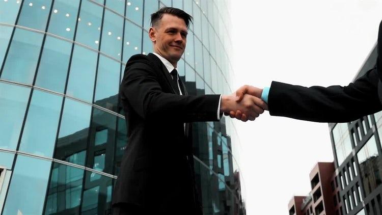 Business Associates Shaking Hands: Stock Video