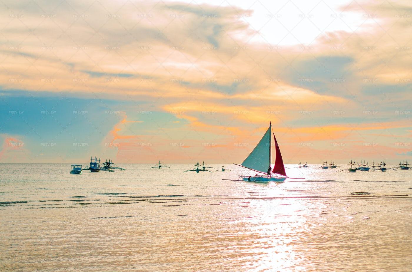 Sailing Boat At Sunset: Stock Photos