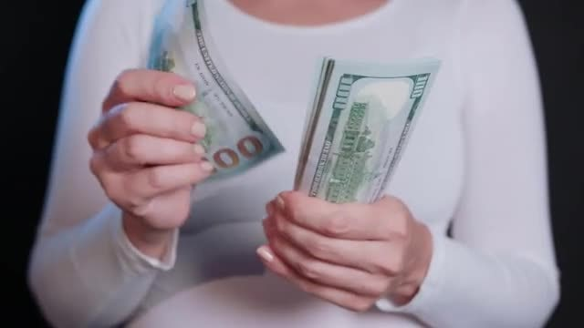 Woman Counting Money: Stock Video