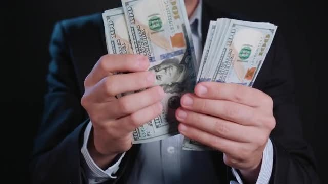 Man Counting Hundreds Dollars: Stock Video